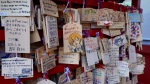 Anime Ema plaques at Kanda Shrine display worshippers' prayers and wishes.