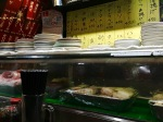 Waiting for my first Yakatori meal in a tiny place with room for seven patrons at a counter.