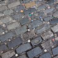 Bottle caps embedded in street in Temple Bar
